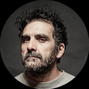 Headshot of man with dark hair and beard