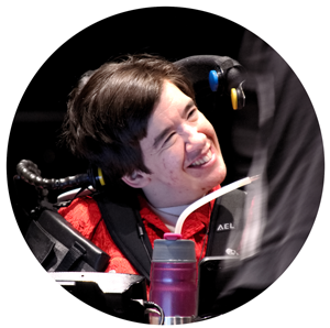 Woman in red shirt sitting in wheelchair smiling